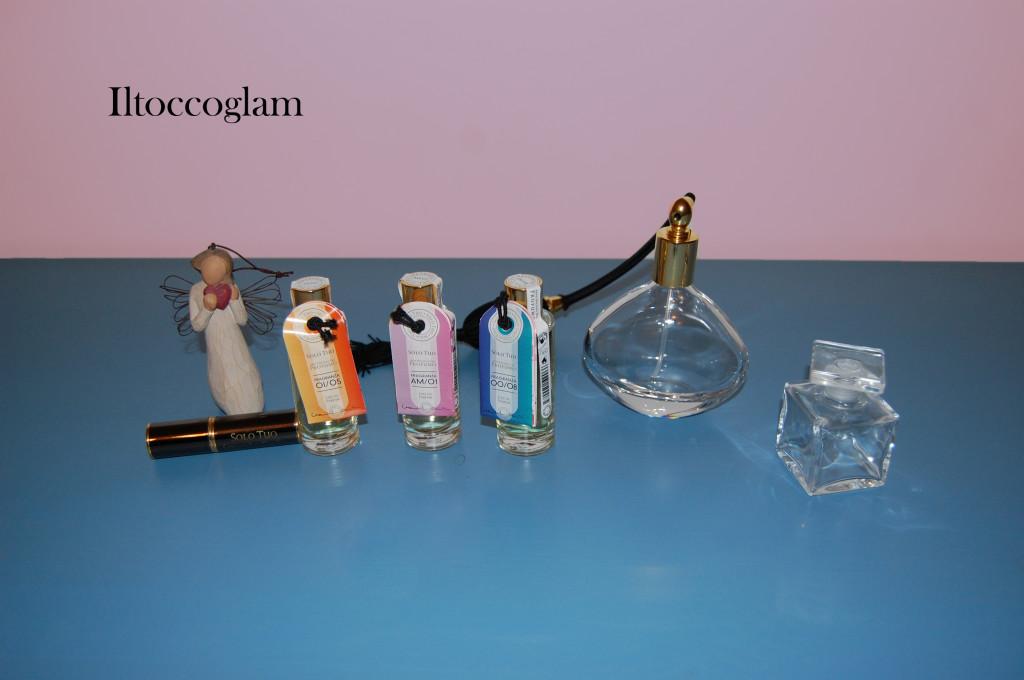 Tre gradazioni di profumi, boccetta da borsetta e due boccette per contenere i profumi