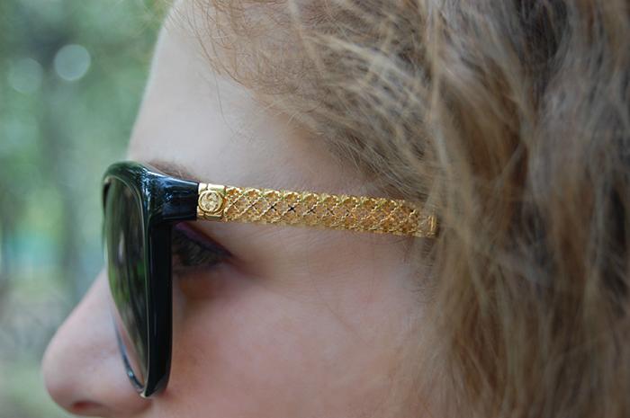 occhiali da sole gucci nero e oro
